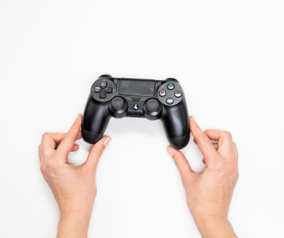 Woman holding black Sony Ps 4 game controller